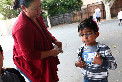 Jarumu Ortigoza puts a name tag on her son, Dylan Jimenez, as she drops him off for a kickoff to kindergarten class at Sunnybrea Elementary School in San Mateo, Calif., on Thursday, July 7, 2016. The summer class helps students who are second-language learners, and those that have never been to preschool a chance to become better prepared before they enter kindergarten. (Gary Reyes/Bay Area News Group)
