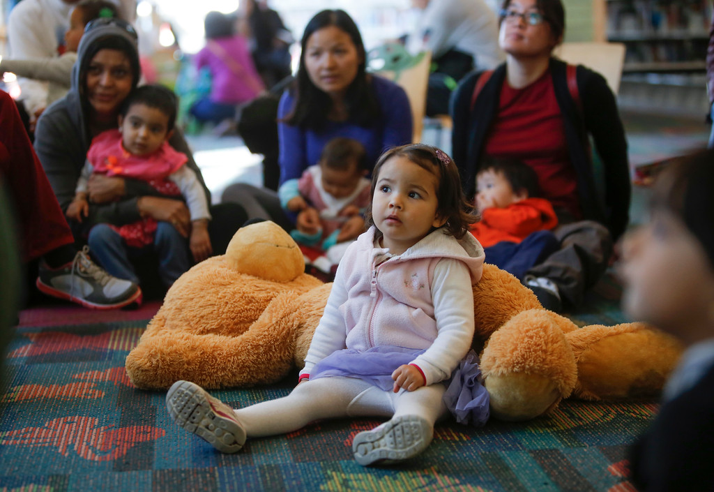. Kids and parents listen to stories about cats and kittens during children\'s story time at the library in Foster City, Calif., on Saturday, Feb. 1, 2014. (John Green/Bay Area News Group)