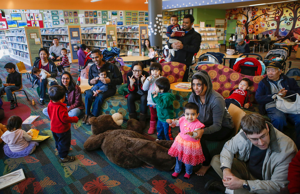 . Kids and parents listen to stories about cats during children\'s story time at the library in Foster City, Calif., on Saturday, Feb. 1, 2014. (John Green/Bay Area News Group)