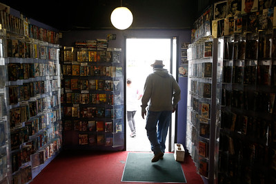 Friend and customer Eddie Gamble, of San Mateo, leaves the store with his granddaughter, Araya Corral, 10, at Captain Video in San Mateo, Calif., on Friday, June 17, 2016. (Jim Gensheimer/Bay Area News Group)