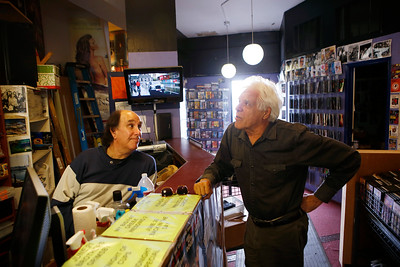 Store owner Ira Belfer, at left, discusses movie options with a customer, Robert Caughlan, of San Mateo, at Captain Video in San Mateo, Calif., on Friday, June 17, 2016. (Jim Gensheimer/Bay Area News Group)