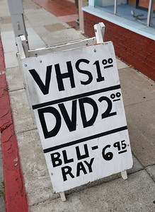 A sandwich board lists rental prices outside  the Captain Video store in San Mateo, Calif., on Friday, June 17, 2016. (Jim Gensheimer/Bay Area News Group)