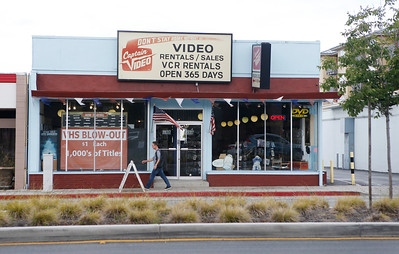 A pedestrian walks past Captain Video on El Camino in San Mateo, Calif., on Friday, June 17, 2016. The movie rental store has survived for over thirty years. (Jim Gensheimer/Bay Area News Group)