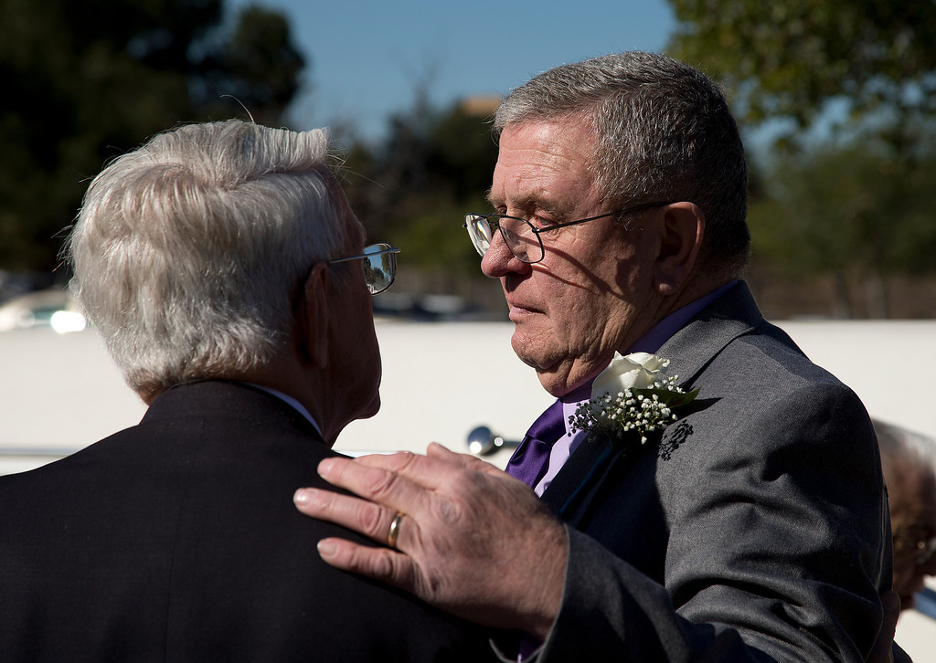 . At right, Dale Smith\'s father, Steve Smith is consoled by Ken Elsey after the funeral for Dale Smith and four family members at the LDS Church in San Jose, Calif., on Saturday, Feb.1, 2014. A plane piloted by Dale Smith crashed on Dec. 1, 2013 carrying his daughter Amber Smith and her fiancee, Jonathan Norton; and son Daniel Smith and his wife, Sheree.  (LiPo Ching/Bay Area News Group)