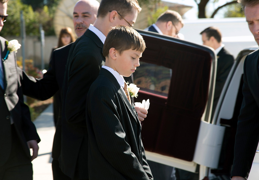 . Dale Smith\'s son, Nathan Smith, reacts after helping to place his father\'s casket in the hearse at the funeral for Smith and four family members at the LDS Church in San Jose, Calif., on Saturday, Feb.1, 2014.  A plane piloted by Smith crashed on Dec. 1, 2013 carrying his daughter Amber Smith and her fiancee, Jonathan Norton; and son Daniel Smith and his wife, Sheree.  (LiPo Ching/Bay Area News Group)
