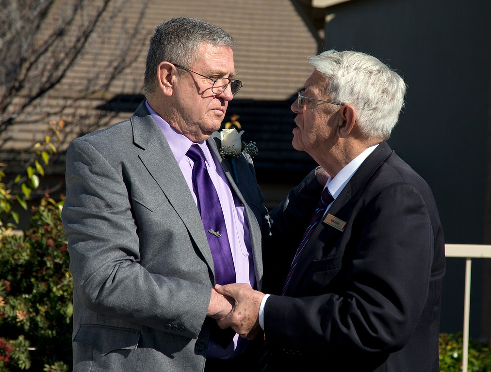 . At left, Dale Smith\'s father, Steve Smith is consoled by mortuary church representative Ken Elsey after the funeral for Dale Smith and four family members at the LDS Church in San Jose, Calif., on Saturday, Feb.1, 2014. A plane piloted by Dale Smith crashed on Dec. 1, 2013 carrying his daughter Amber Smith and her fiancee, Jonathan Norton; and son Daniel Smith and his wife, Sheree.  (LiPo Ching/Bay Area News Group)