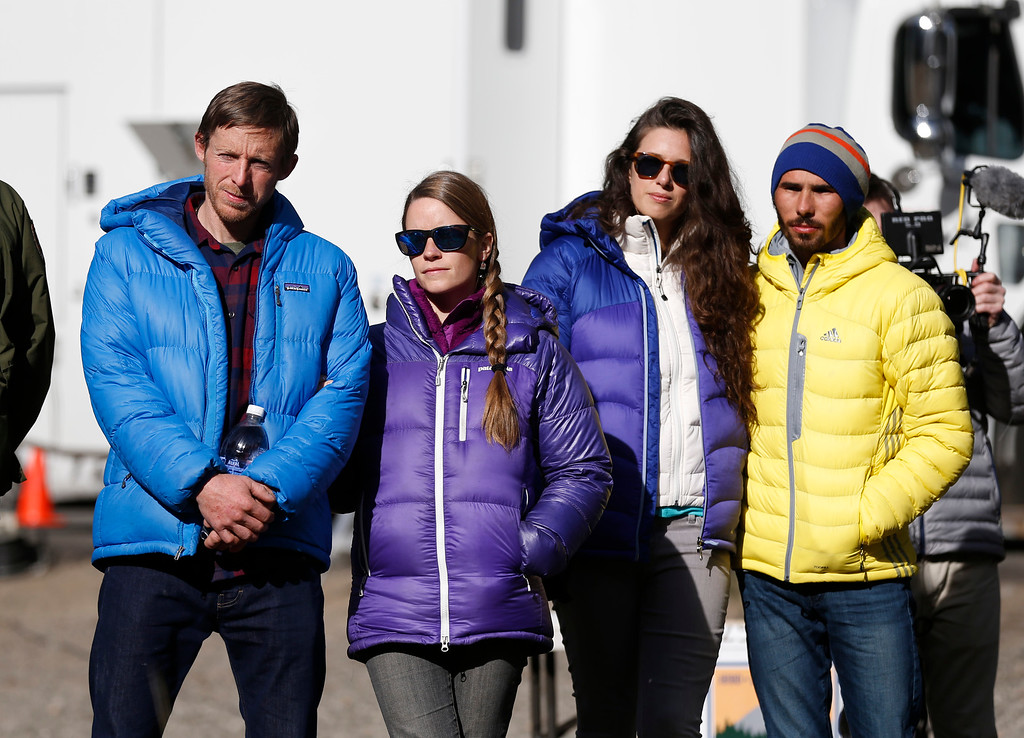 """. Tommy Caldwell, 36, left, of Estes Park, Colo.,, with his wife, Rebecca Caldwell, and Kevin Jorgeson, 30, of Santa Rosa with girlfriend, Jacqui Becker, wait to speak to the media in Yosemite National Park, Calif., Thursday, Jan. 15, 2015. On Wednesday, the pair completed the ascent of the Dawn Wall of El Capitan. They were the first to do so as \""""free climbers,\"""" that is they performed their ascent without the assistance of ropes or other mechanical assistance other than being tethered to protect themselves from falls. The two men began their ascent of the half-mile of sheer granite on Dec. 27, 2014. (Patrick Tehan/Bay Area News Group)"""