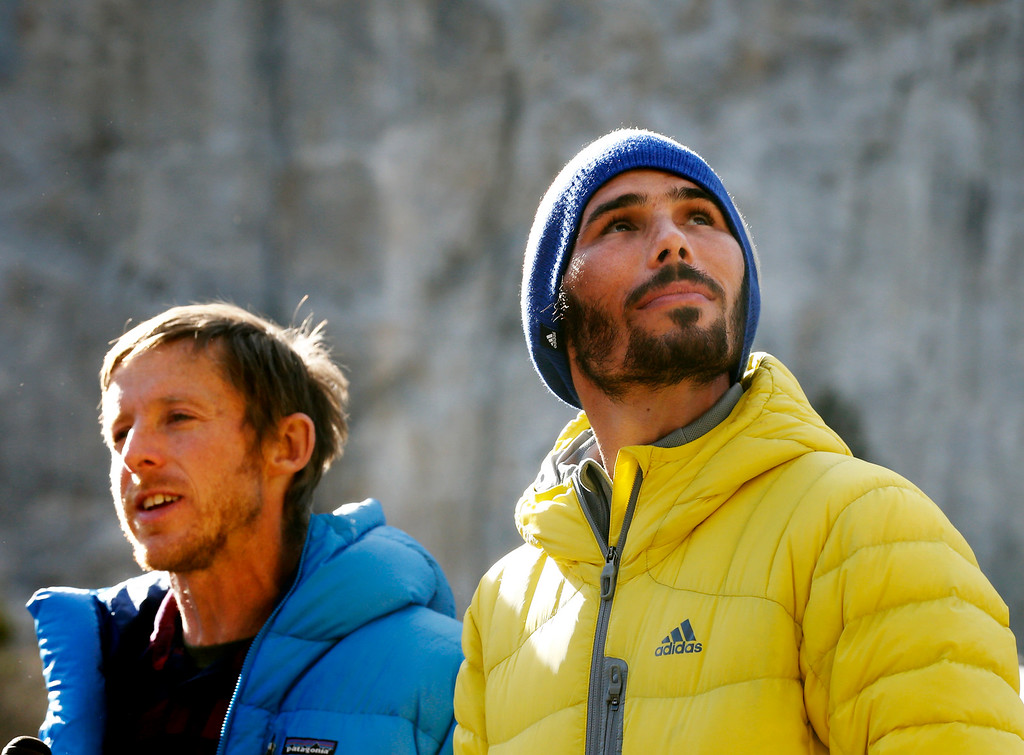 """. Kevin Jorgeson, 30, of Santa Rosa, looks up at El Capitan as his fellow climber, Tommy Caldwell, 36, of Estes Park, Colo., speaks to the media in Yosemite National Park, Calif., Thursday, Jan. 15, 2015. On Wednesday, the pair completed the ascent of the Dawn Wall of El Capitan. They were the first to do so as \""""free climbers,\"""" that is they performed their ascent without the assistance of ropes or other mechanical assistance other than being tethered to protect themselves from falls. The two men began their ascent of the half-mile of sheer granite on Dec. 27, 2014. (Patrick Tehan/Bay Area News Group)"""
