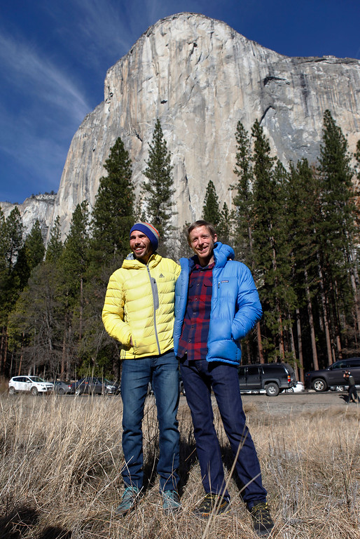 """. Climbers Kevin Jorgeson, 30, of Santa Rosa, left, and Tommy Caldwell, 36, of Estes Park, Colo., pose for a photo in front of El Capitan in Yosemite National Park, Calif., Thursday, Jan. 15, 2015. On Wednesday, the pair completed the ascent of the Dawn Wall of El Capitan. They were the first to do so as \""""free climbers,\"""" that is they performed their ascent without the assistance of ropes or other mechanical assistance other than being tethered to protect themselves from falls. The two men began their ascent of the half-mile of sheer granite on Dec. 27, 2014. (Patrick Tehan/Bay Area News Group)"""