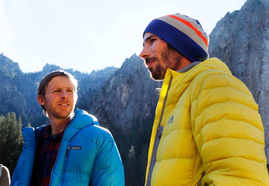 ". Climbers Tommy Caldwell, 36, of Estes Park, Colo.,, left, and Kevin Jorgeson, 30, of Santa Rosa speak to the media in Yosemite National Park, Calif., Thursday, Jan. 15, 2015. On Wednesday, the pair completed the ascent of the Dawn Wall of El Capitan. They were the first to do so as ""free climbers,\"" that is they performed their ascent without the assistance of ropes or other mechanical assistance other than being tethered to protect themselves from falls. The two men began their ascent of the half-mile of sheer granite on Dec. 27, 2014. (Patrick Tehan/Bay Area News Group)"