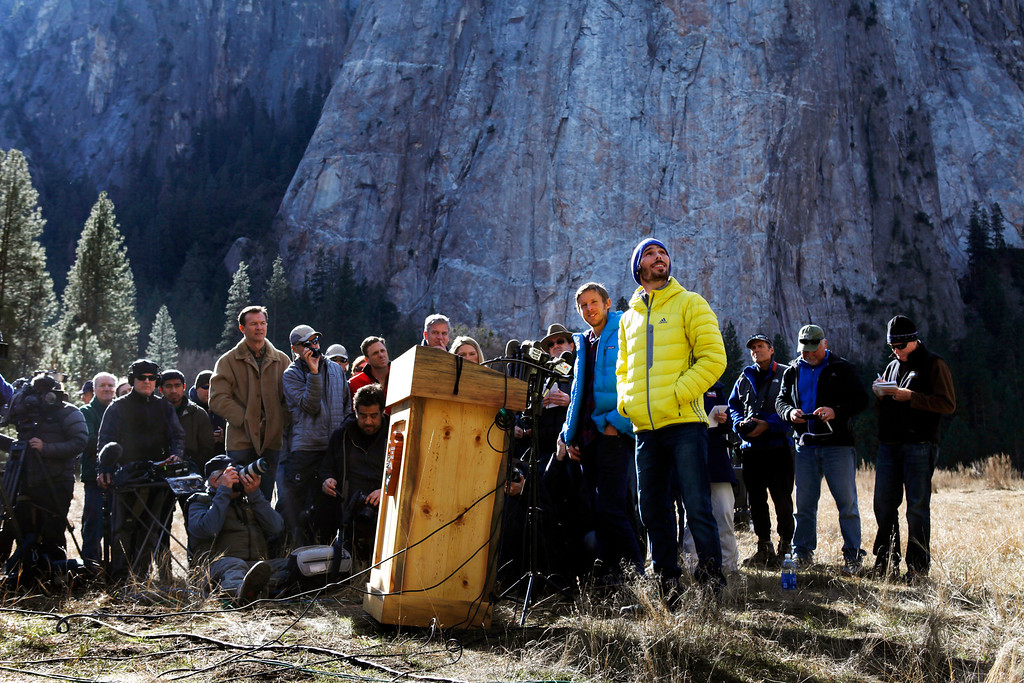 """. Climbers Tommy Caldwell, 36, of Estes Park, Colo., (in blue jacket) and Kevin Jorgeson, 30, of Santa Rosa (in yellow jacket) speak to the media in Yosemite National Park, Calif., Thursday, Jan. 15, 2015. On Wednesday, the pair completed the ascent of the Dawn Wall of El Capitan. They were the first to do so as \""""free climbers,\"""" that is they performed their ascent without the assistance of ropes or other mechanical assistance other than being tethered to protect themselves from falls. The two men began their ascent of the half-mile of sheer granite on Dec. 27, 2014. (Patrick Tehan/Bay Area News Group)"""