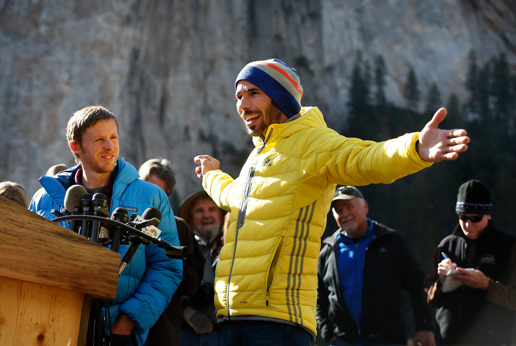 """. Kevin Jorgeson, 30, of Santa Rosa speaks to the media as his fellow climber, Tommy Caldwell, 36, of Estes Park, Colo.,, looks on in Yosemite National Park, Calif., Thursday, Jan. 15, 2015. On Wednesday, the pair completed the ascent of the Dawn Wall of El Capitan. They were the first to do so as \""""free climbers,\"""" that is they performed their ascent without the assistance of ropes or other mechanical assistance other than being tethered to protect themselves from falls. The two men began their ascent of the half-mile of sheer granite on Dec. 27, 2014. (Patrick Tehan/Bay Area News Group)"""