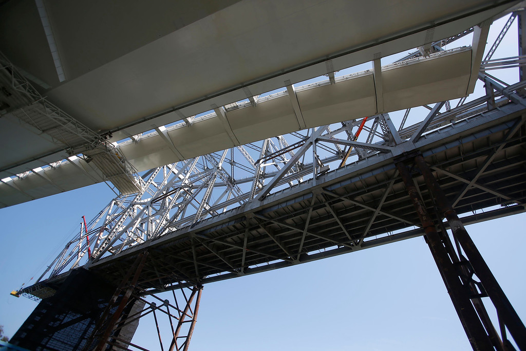 . The dismantling of the eastern span of the old Bay Bridge is seen from underneath the new Bay Bridge on Yerba Buena Island in San Francisco, Calif., on Thursday, Sept. 4, 2014. (Jane Tyska/Bay Area News Group)