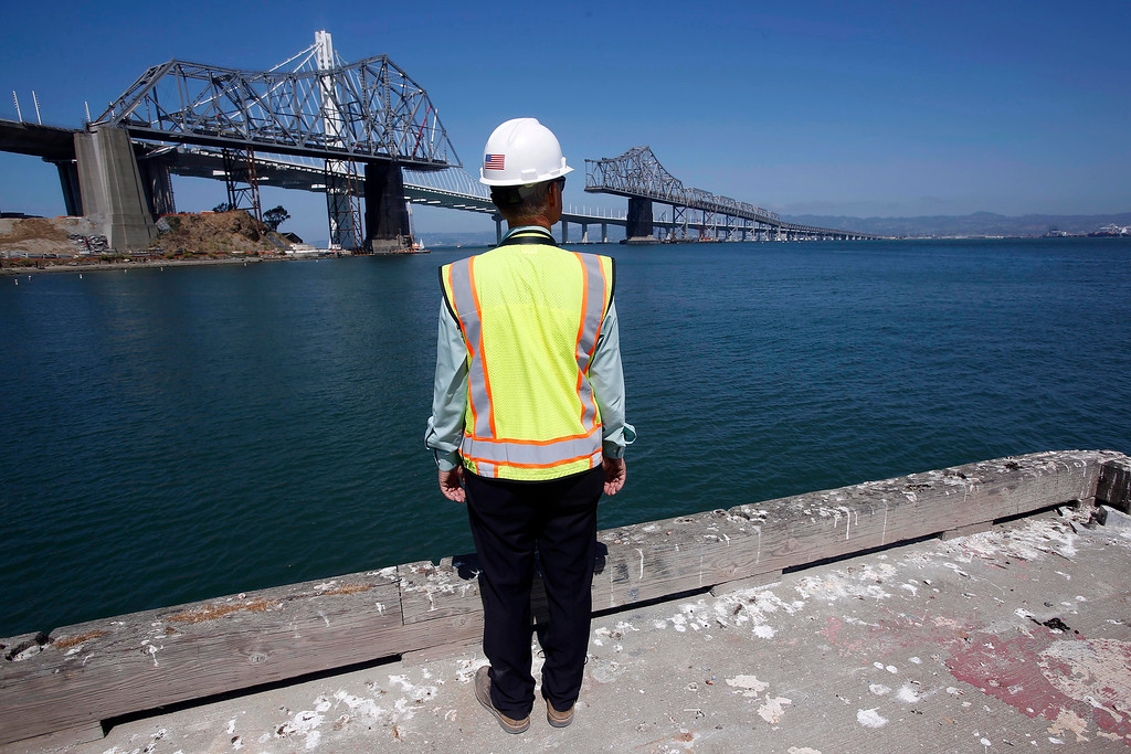 . California Engineering Safety Director Robert Ikenberry views the approximately 800-foot gap in the eastern span of the old Bay Bridge from the U.S. Coast Guard dock on Yerba Buena Island in San Francisco, Calif., on Thursday, Sept. 4, 2014. (Jane Tyska/Bay Area News Group)