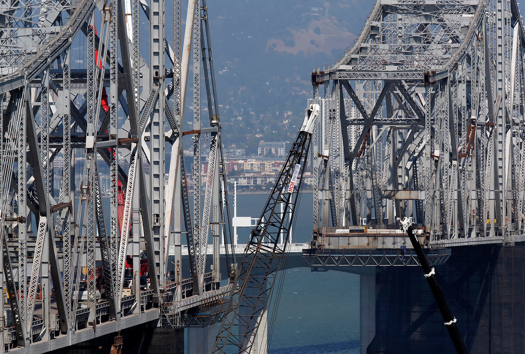 . The dismantling of the eastern span of the old Bay Bridge is seen from Yerba Buena Island in San Francisco, Calif., on Thursday, Sept. 4, 2014. (Jane Tyska/Bay Area News Group)