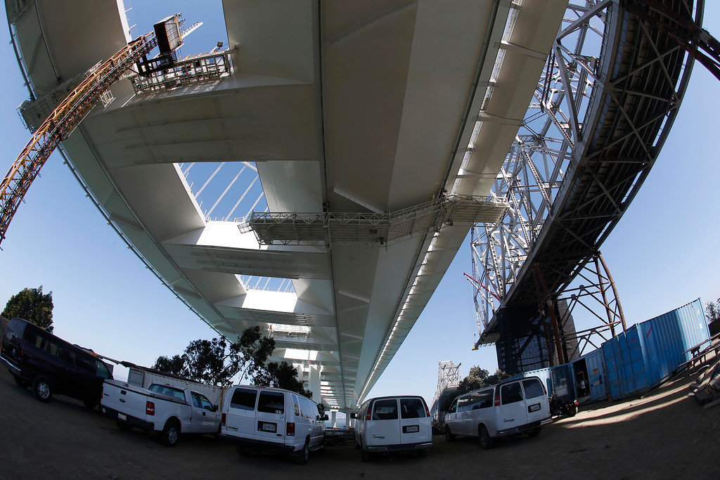 . The dismantling of the eastern span of the old Bay Bridge, right, is seen from underneath the new Bay Bridge on Yerba Buena Island in San Francisco, Calif., on Thursday, Sept. 4, 2014. Photo made with an extreme wide-angle lens. (Jane Tyska/Bay Area News Group)