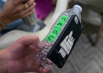 Design teams built a prototype of a pill-dispensing water bottle holder during the Design Daze event sponsored by The DFarm at the Ronald McDonald House at Stanford in Palo Alto, Calif., on Saturday, August 13, 2016.  The holder contains pill boxes and a smartphone holder for phone apps that uses games to dispense pills.   (LiPo Ching/Bay Area News Group)