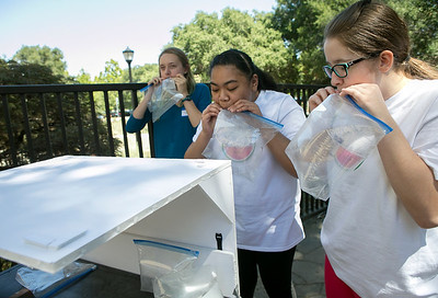 From right, Alisah Bowman-McVay, 15, kidney failure patient Sina Sulunga-Kahaialii, 15, and Lucy Volino, 14, blow up plastic bags to represent dextrose bags for their prototype of an adjustable cart for a bedside dialysis machine during the Design Daze event sponsored by The DFarm at the Ronald McDonald House at Stanford in Palo Alto, Calif., on Saturday, August 13, 2016. (LiPo Ching/Bay Area News Group)