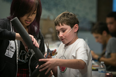 From left, volunteer Chloe Hong, 16, helps double lung transplant patient Zack Hart, 12, with a medicine dispensing water bottle holder prototype during the Design Daze event sponsored by The DFarm at the Ronald McDonald House at Stanford in Palo Alto, Calif., on Saturday, August 13, 2016. (LiPo Ching/Bay Area News Group)