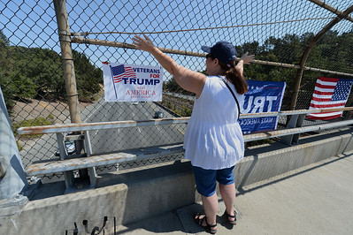 Trump delegate Janet Cordova, of Danville, waves from an overpass in Orinda, Calif., on Saturday, Aug. 27, 2016. Trump supporters from California boasted that they were building a volunteer army that would help rally kindred spirits from throughout the state. (Dan Honda/Bay Area News Group)
