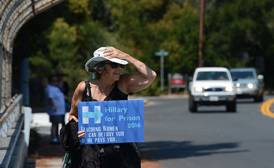 Thyme Siegel, of Walnut Creek, makes her feelings known with a sign she carried along an overpass in Orinda, Calif., on Saturday, Aug. 27, 2016. Trump supporters from California boasted that they were building a volunteer army that would help rally kindred spirits from throughout the state. (Dan Honda/Bay Area News Group)