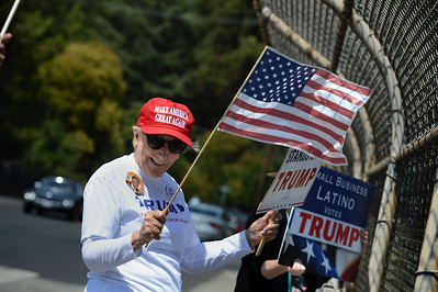 Fran Cavenaugh, of Rossmoor, shows her support for Presidential candidate Donald Trump on an overpass in Orinda, Calif., on Saturday, Aug. 27, 2016. Trump supporters from California boasted that they were building a volunteer army that would help rally kindred spirits from throughout the state. (Dan Honda/Bay Area News Group)