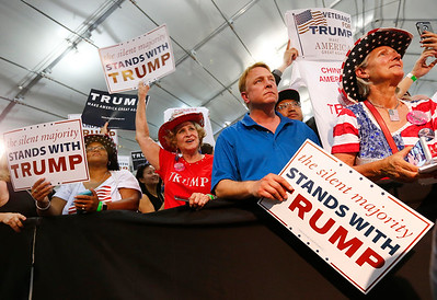 Trump supporters cheer from front row as presidential candidate Donald Trump speaks to the crowd at a rally at the San Jose Convention Center in San Jose, Calif., on Thursday, June 2, 2016. (Gary Reyes/Bay Area News Group)