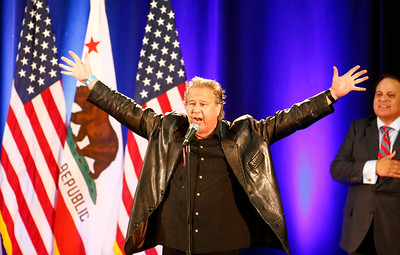 Greg Kihn, local rock musician, finishes the National Anthem at the Donald Trump rally at the San Jose Convention Center in San Jose, Calif., on Thursday, June 2, 2016. (Gary Reyes/Bay Area News Group)