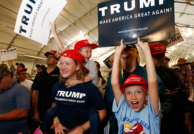Annalisa Wales, 12, left, Scarlett Wales, 9, rear, and Katherine Wales, 10, below right, cheer with their mother, Barbara Wales, following the flag salute during a Donald Trump rally at the San Jose Convention Center in San Jose, Calif., on Thursday, June 2, 2016. The family is from Los Gatos. (Gary Reyes/Bay Area News Group)