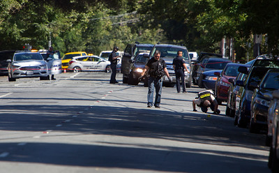 San Jose Police Department Crime Scene investigators search the intersection of E. San Carlos St. and S. 11th Street after a shooting homicide in downtown San Jose, Calif., on Tuesday, June 28, 2016. (LiPo Ching/Bay Area News Group)
