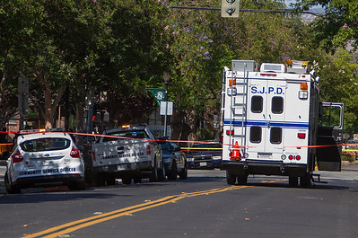 A San Jose Police Department Crime Scene vehicle is parked near the intersection of E. San Carlos St. and S. 11th Street after a shooting homicide in downtown San Jose, Calif., on Tuesday, June 28, 2016. (LiPo Ching/Bay Area News Group)