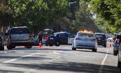 San Jose Police Department officers block  the intersection of E. San Carlos St. and S. 11th Street after a shooting homicide in downtown San Jose, Calif., on Tuesday, June 28, 2016. (LiPo Ching/Bay Area News Group)