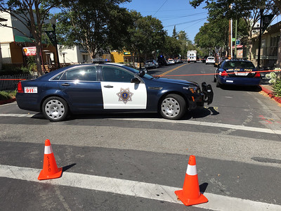A San Jose Police Department patrol car blocks the intersection of E. San Carlos St. and S. 10th Street after a shooting homicide in downtown San Jose, Calif., on Tuesday, June 18, 2016. (LiPo Ching/Bay Area News Group)