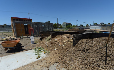A compost area and chicken coop photographed at City Slicker Farms in Oakland, Calif., on Friday, June 24, 2016. This urban farm grows and sells their produce on site in a totally urban setting. (Dan Honda/Bay Area News Group)