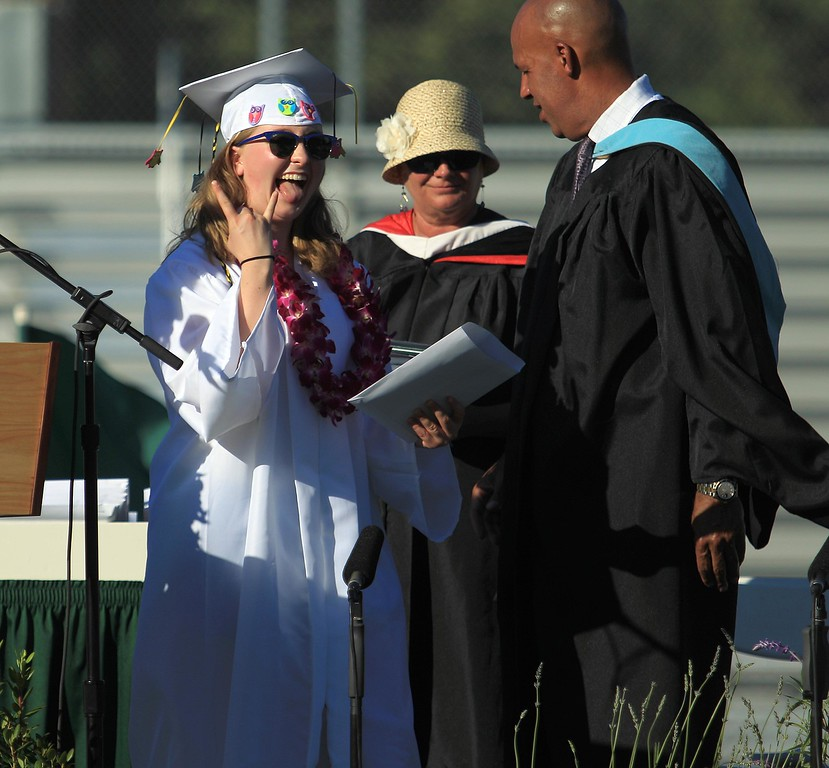 . Nora Ross celebrates after receiving her diploma during Miramonte High School\'s 54th commencement ceremony  in Orinda, Calif., on Friday, June 7, 2013.  (Jane Tyska/Bay Area News Group)