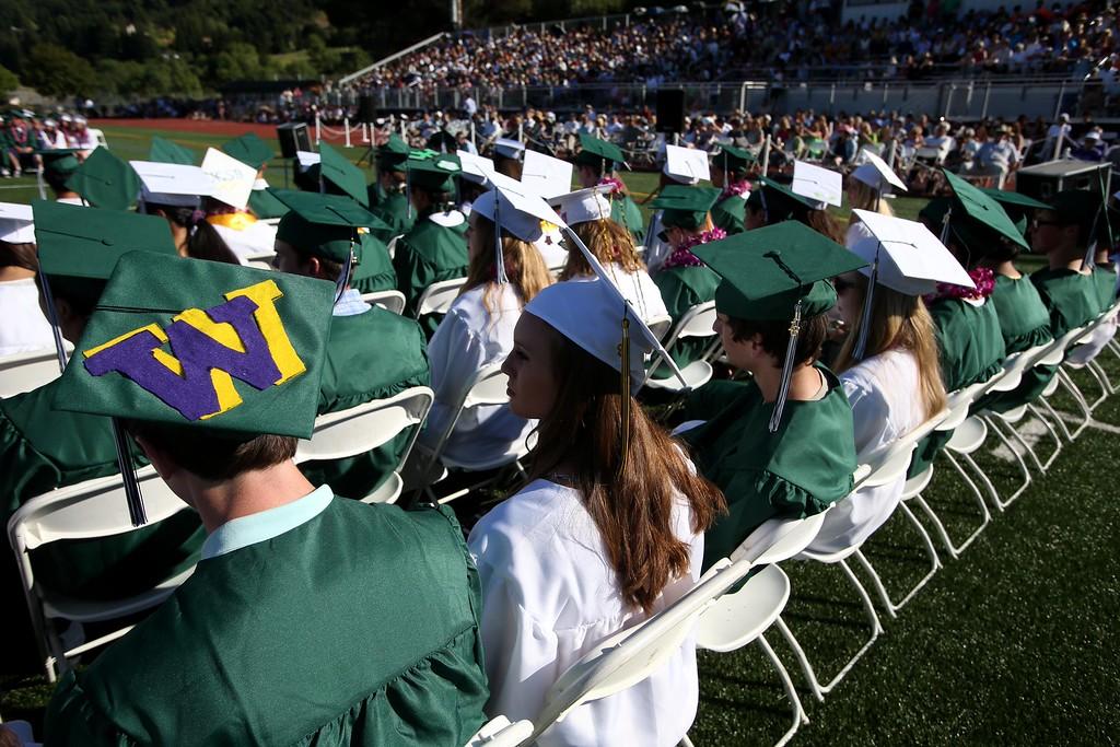 . Graduates listen to speakers during Miramonte High School\'s 54th commencement ceremony in Orinda, Calif., on Friday, June 7, 2013. (Jane Tyska/Bay Area News Group)