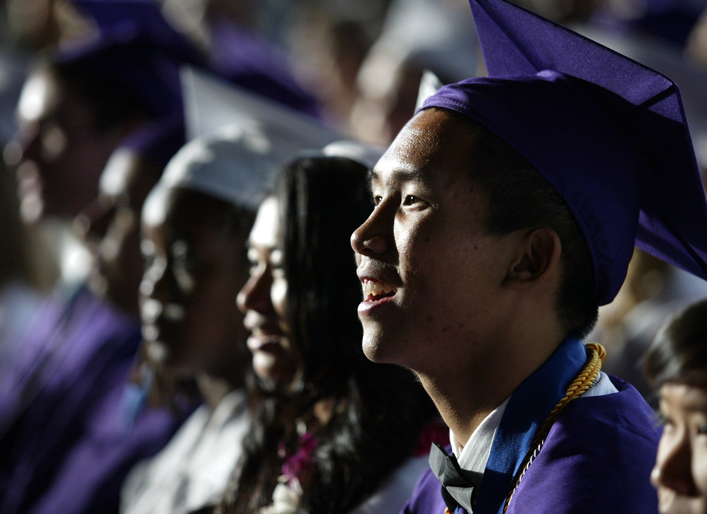 . Seniors of the Class of 2013 listen to speakers during the College Park High School graduation ceremony at the Sleep Train Pavilion in Concord, Calif., on Tuesday, June 12, 2013. (Ray Chavez/Bay Area News Group)