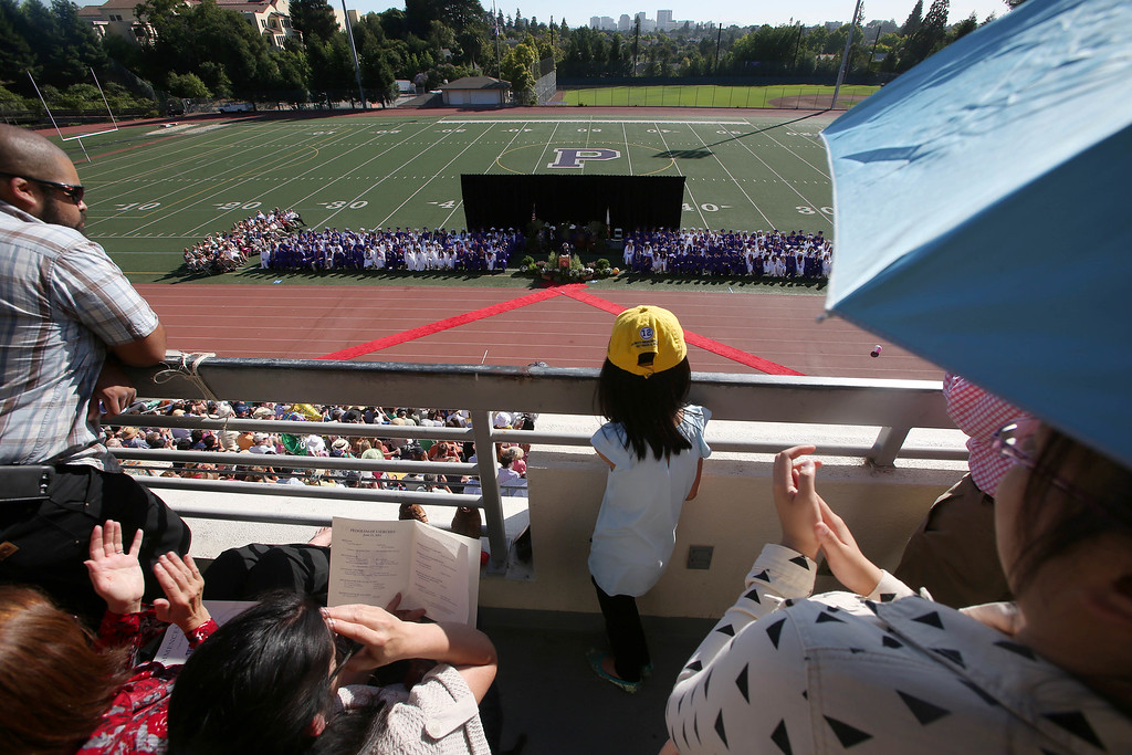 . Family and friends watch from the bleachers at Witter Field during commencement ceremonies at Piedmont High School in Piedmont, Calif., on Thursday, June 13, 2013. . (Jane Tyska/Bay Area News Group)