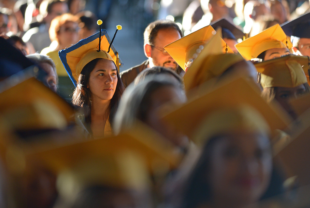 . Ygnacio Valley High School student Sasha Castro-Marcello, 18, shows off her antenna while sitting during commencement ceremonies at Sleep Train Pavilion in Concord, Calif., on Thursday, June 13, 2013. Sasha likes snails and thought it would be nice to wear antenna to her graduation. (Jose Carlos Fajardo/Bay Area News Group)