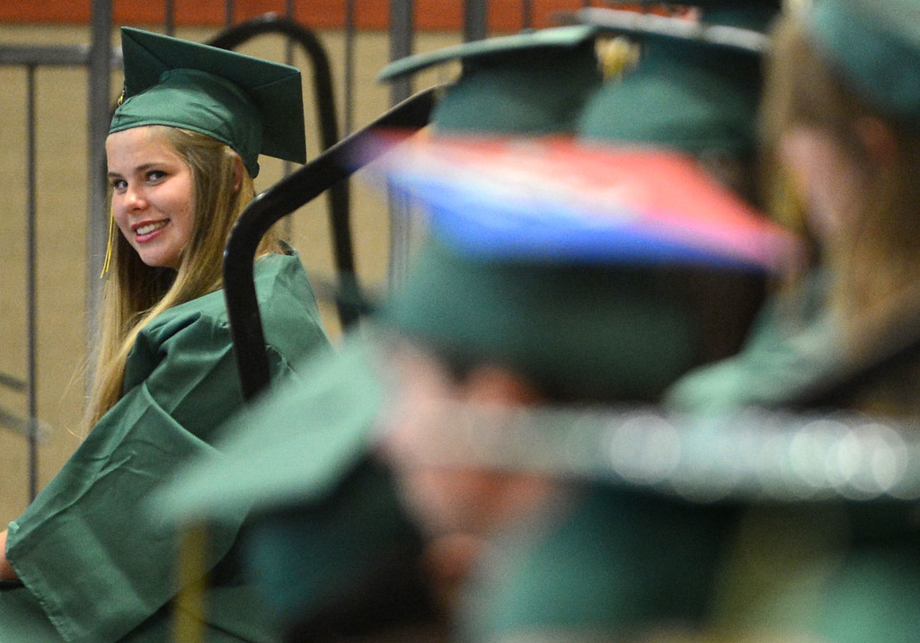 . Swedish foreign exchange student Jessica Amneryd smiles at other classmates before the start of the school\'s Commencement Ceremony in Danville, Calif., on Friday, June 14, 2013. (Doug Duran/Bay Area News Group)