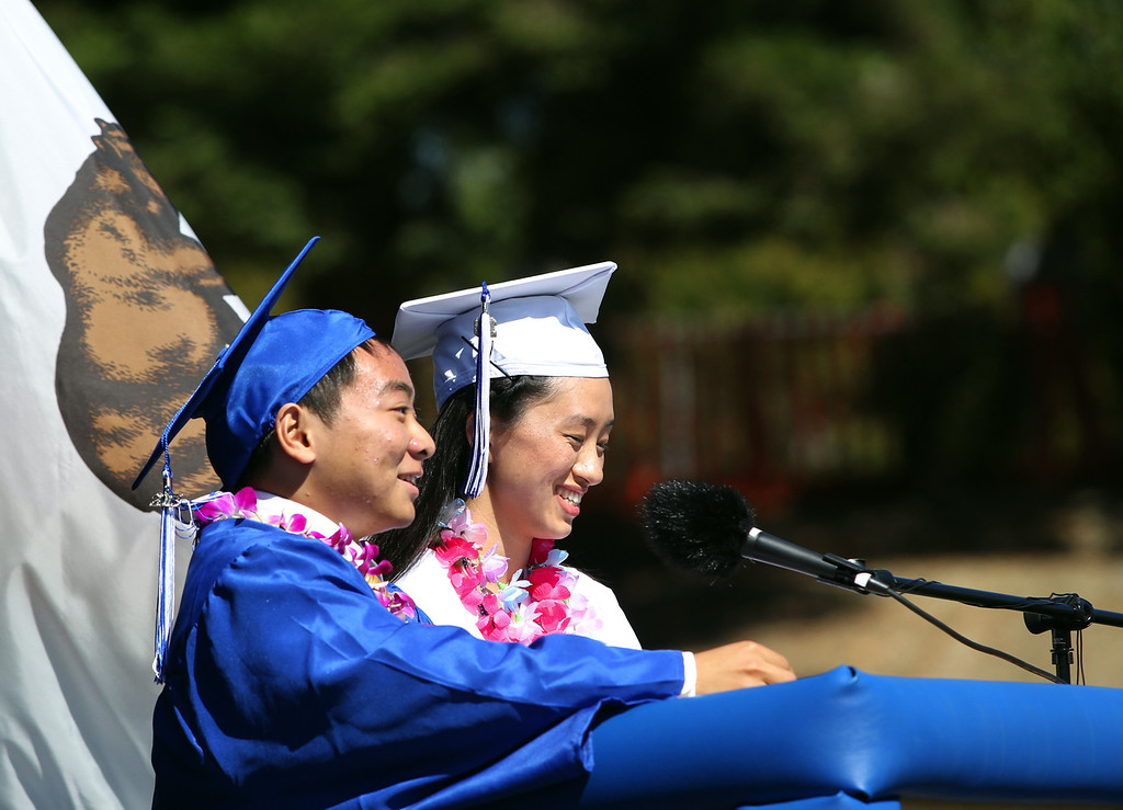 . Valedictorian Andrew Wang, 18, and Salutatorian Anchi Wu, 18, from left, Irvington High School graduates address their fellow classmates at their commencement ceremony in Fremont, Calif., on Thursday, June 20, 2013. (Anda Chu/Bay Area News Group)