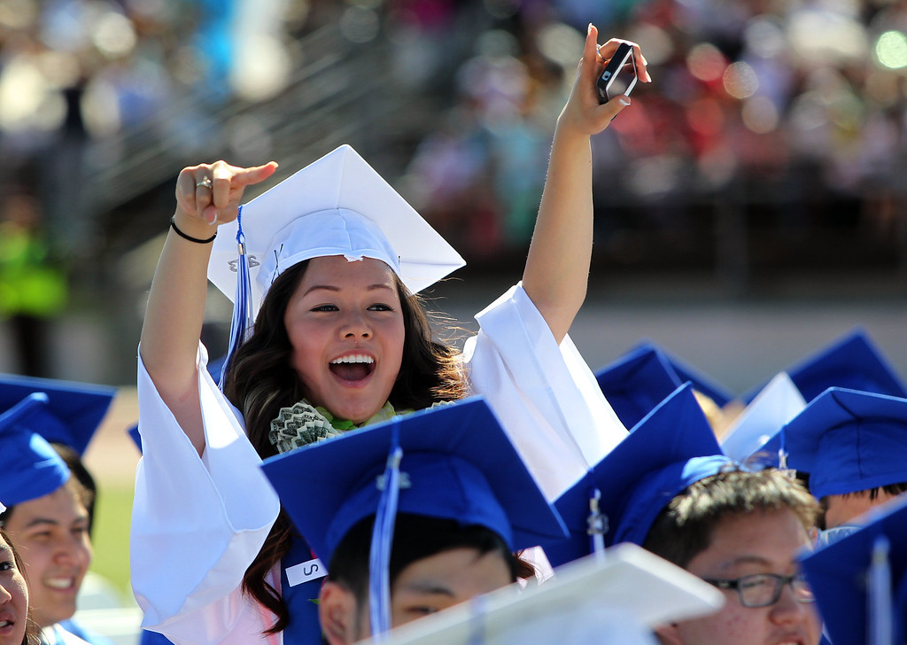. Abby Wong, 18, Irvington High School graduate cheers for classmates during their commencement ceremony in Fremont, Calif., on Thursday, June 20, 2013. (Anda Chu/Bay Area News Group)