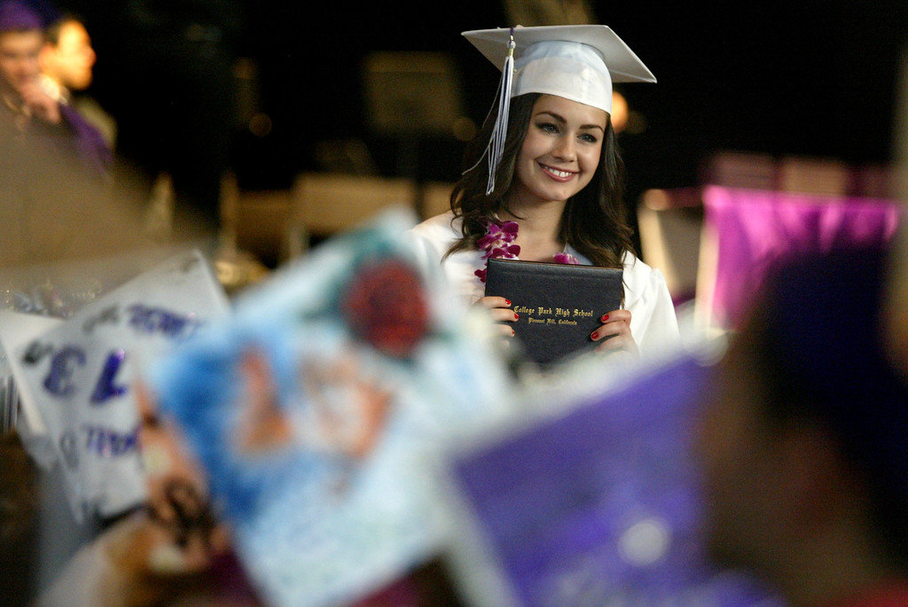 . A graduate shows off her diploma of the Class of 2013 during the College Park High School graduation ceremony at the Sleep Train Pavilion in Concord, Calif., on Tuesday, June 12, 2013.  (Ray Chavez/Bay Area News Group)