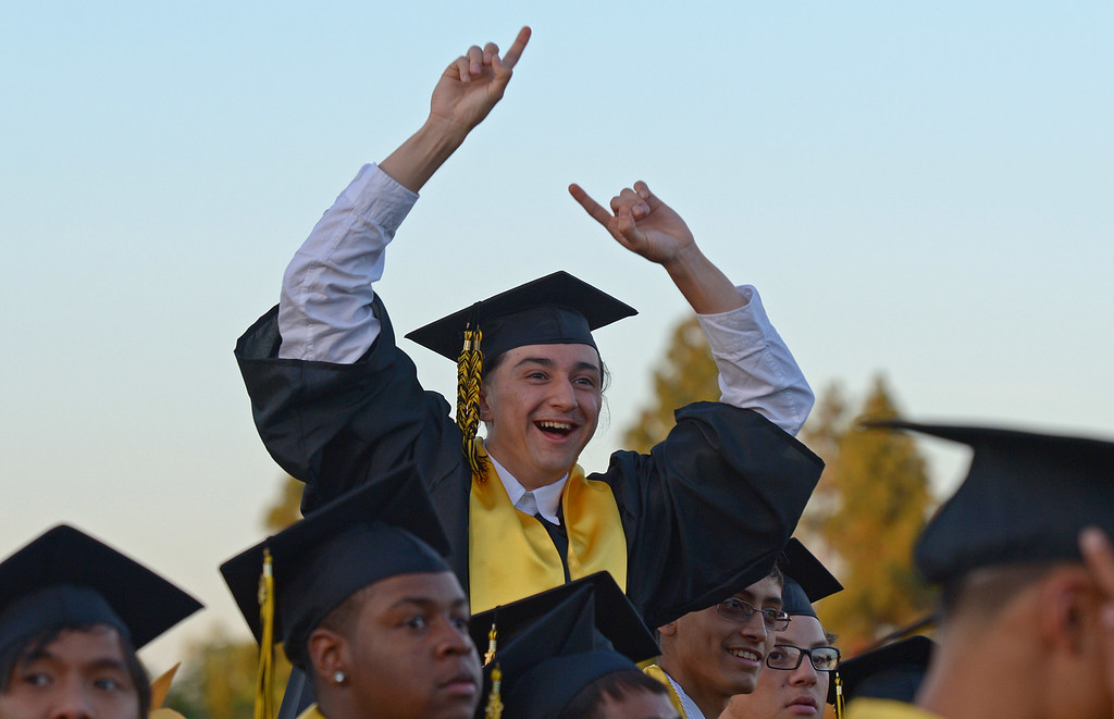 . Jesus Madrid, 18, signals to his family while attending graduation ceremonies at Antioch High School in Antioch, Calif., on Thursday, June 6, 2013. (Jose Carlos Fajardo/Bay Area News Group)