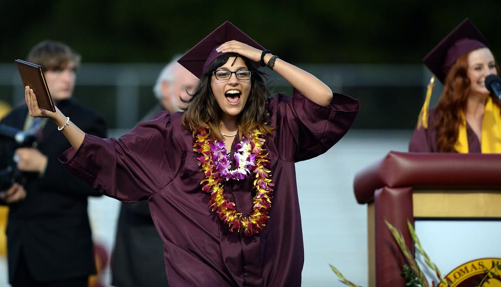 . Sara Zavala is all smiles after receiving her diploma at the 2013 Las Lomas High School Commencement held on the Las Lomas High School campus in Walnut Creek, Calif. on Friday, June 7, 2013. (Dan Honda/Bay Area News Group)