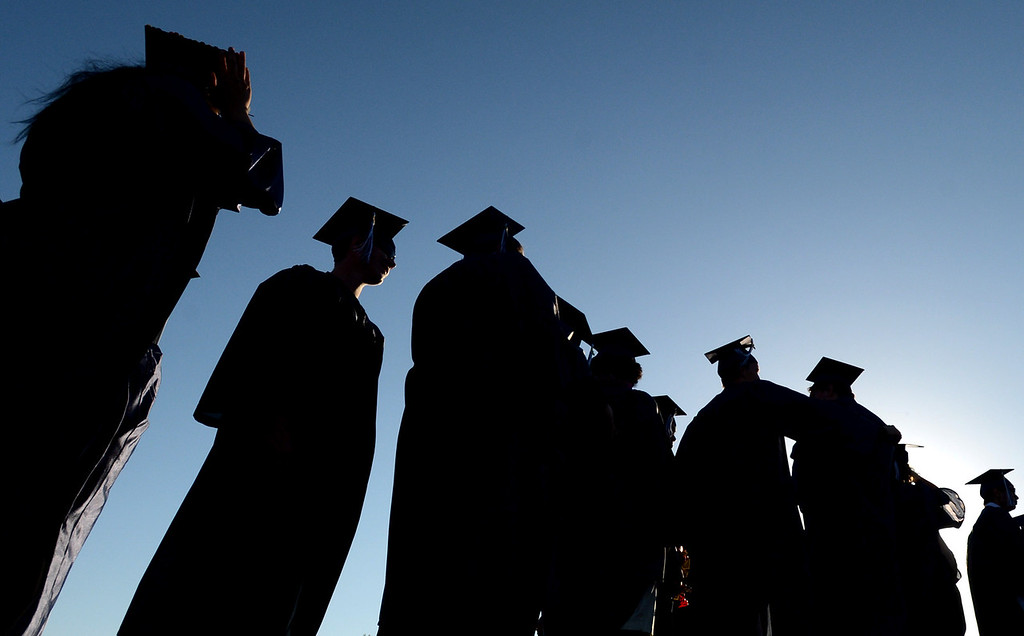 . Graduates line up before the start of their commencement ceremony for Vicente-Martinez High School and Briones School in Martinez, Calif., on Wednesday, June 5, 2013. The graduation also featured class speeches by graduates Maalec Thomas and Serenity McGill, a performance by graduate Nicholas Napolitano and scholarship presentations by Martinez organizations. (Doug Duran/Bay Area News Group)