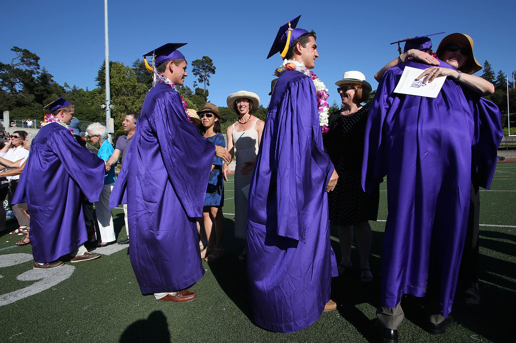 . Teachers Beth Black, left center, Allison Cota, right center, and Janet Labberton, right, congratulate students after they received their diplomas during commencement ceremonies at Piedmont High School in Piedmont, Calif., on Thursday, June 13, 2013. (Jane Tyska/Bay Area News Group)