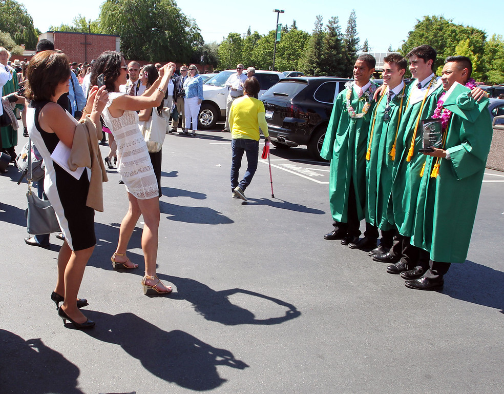 . De La Salle graduates of the Class of 2013 have their picture made by family members and friends following their commencement ceremony at De La Salle High School in Concord, Calif., on Sunday, May 19, 2013. (Ray Chavez/Bay Area News Group)