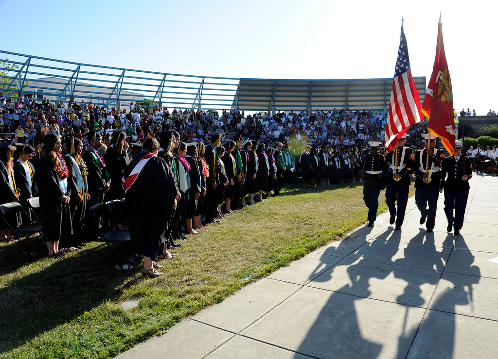 . Members of the United States Marine Corp from left, Pvt. Marc Robertson, Ssgt Rommel Henriquez, Sgt. Francisco De La Puenta and Sgt. Julianna Sandoval serve as the color guard during the Dozier-Libbey Medical High School 2013 Commencement Ceremony held at Deer Valley High School in Antioch, Calif., on Wednesday, June 5, 2013. (Susan Tripp Pollard/Bay Area News Group)