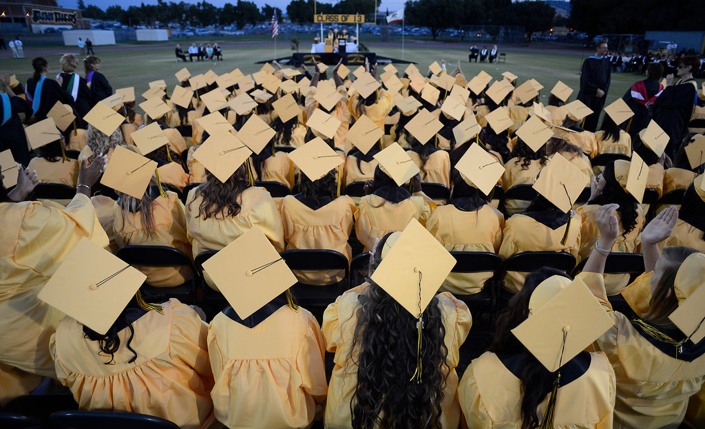 . Students sit while attending graduation ceremonies at Antioch High School in Antioch, Calif., on Thursday, June 6, 2013. (Jose Carlos Fajardo/Bay Area News Group)
